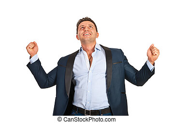 Successful business man cheering and raising hands isolated...