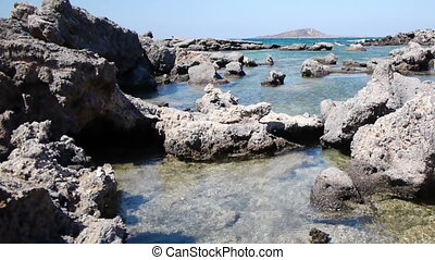 Panoramic shot of a stone bay of Elafonisi Beach, Crete,...