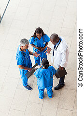 overhead view of medical workers having a meeting at...