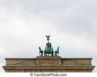 bronze quadriga on brandenburg gate in Belin in cloudy...