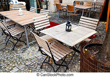 empty outdoor restaurant tables
