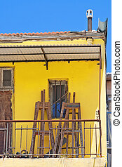 Yellow balcony with easels