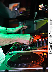 DJ mixing music at a night party