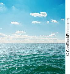 sea close up under clouds on sky