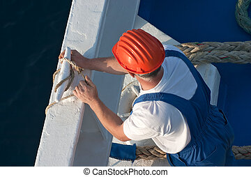 Seaman working on a cruise ship