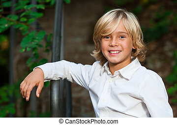 Cute blond boy outdoors - Close up portrait of cute blond...