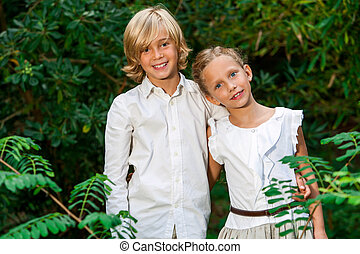 Cute young couple in woods.