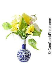 artificial flower on a porcelain vase