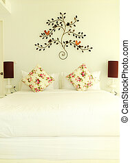 White bedroom - White double bed and lamps
