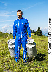 farmer with milk containers - Herdsman standing in front of...