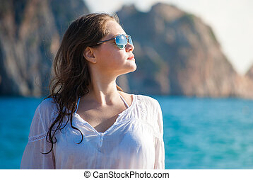 girl in bikini on sea vacation - girl in sunglasses against...