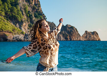 girl in bikini on sea vacation - relaxed girl against Alanya...