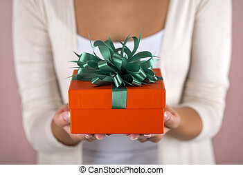 Hands holding beautiful gift box, female giving gift,...