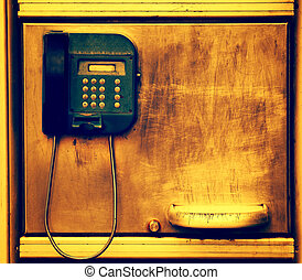 old telephone on grunge metal wall with scratches