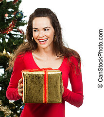 Happy women holding Christmas present