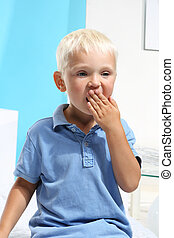 Yawning little boy