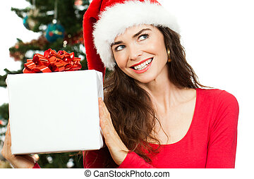 Smiling woman holding Christmas gift - A smiling beautiful...