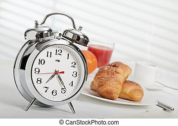 breakfast time - alarm clock at half past seven with...
