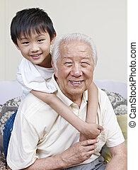asian grandpa and grandson - grandpa and grandson having fun...