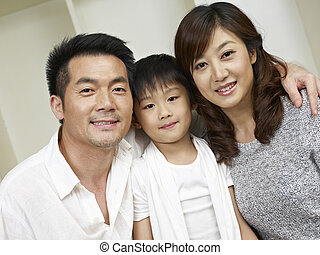 asian family - portrait of an asian family of three
