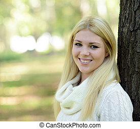 Portrait of happy girl with blonde hair outdoors