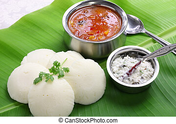 south indian breakfast on banana le - idli, sambar and...