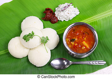 south indian breakfast on banana le - idli, sambar, coconut...