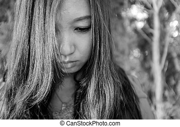 regretful woman - Portrait of young woman looking regretful