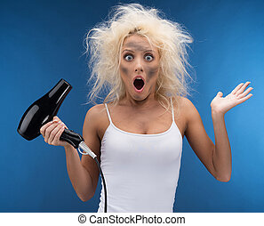 Funny blond girl having problem with hairdryer. Isolated on...