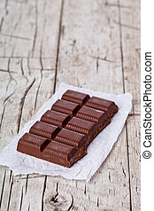 dark chocolate on rustic wooden background