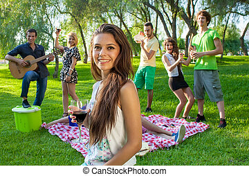 Group of friends partying in the park - Group of young...