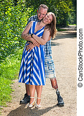 Disabled man and attractive woman in loving hug - Disabled...