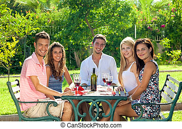 Attractive group of young friends drinking wine