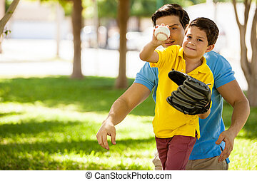 Father and son playing baseball - Cute boy and his young...