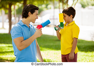 Father and son with water guns
