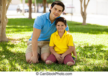 Portrait of a young father and son