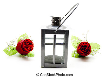 Lantern with roses on white background
