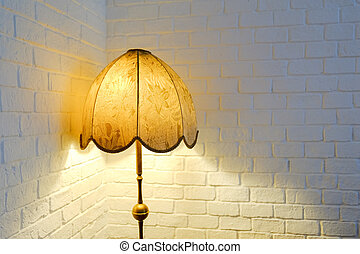 Lit up lamp - Lit up vintage lamp with white brick wall...