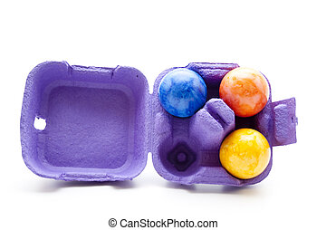 Easter eggs with egg carton on white background
