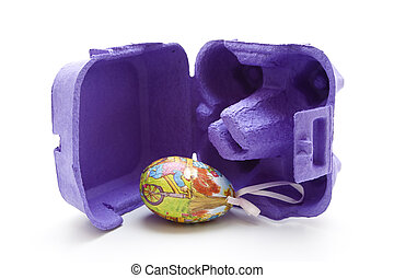 Easter egg with egg carton on white background