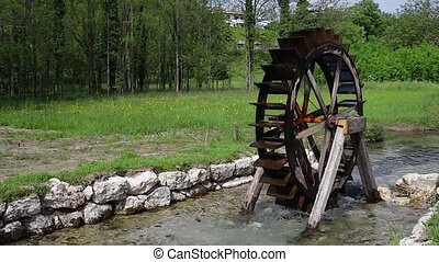 Water wheel in the river - View of Water wheel in the little...