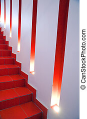 wall of a modern building with lights and niches and red...