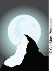 Moonlit Mountain - A view of the matterhorn on a full moon.