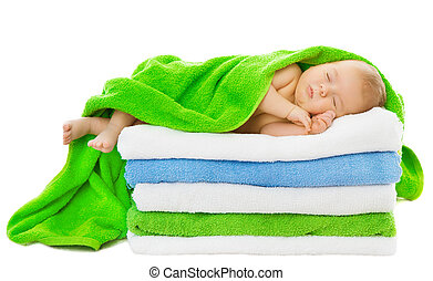 Baby newborn sleeping wrapped in bath towels over white...