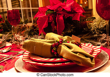 Christmas Dinner Table - Close up of green napkin and plates...
