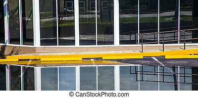 reflection of a house facade in the water