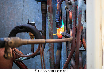 Welding copper pipes and Air conditioner repairman