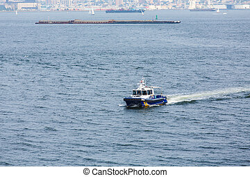 New York City Police Boat Cruising Harbor - A New York City...