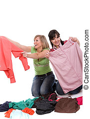 shopaholics - two attractive women with clother