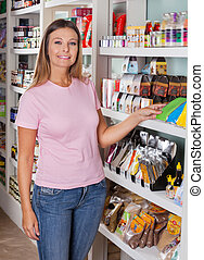 Woman Standing By Shelf In Grocery Store
